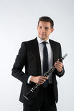 Young man playing the clarinet Royalty Free Stock Photos