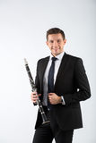 Young man playing the clarinet Stock Photography