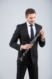 Young man playing the clarinet Stock Photo
