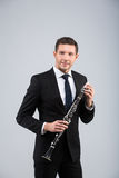 Young man playing the clarinet Stock Photos