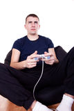 Young man playing computer game Stock Photography