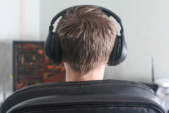 Young man playing computer game. Back of the head view Stock Images