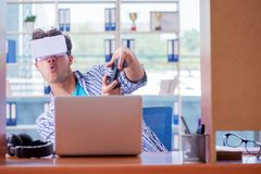 The young man playing computer game with virtual reality glasses Royalty Free Stock Image