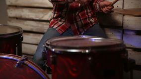 Young man playing drum kit on stage stock video footage