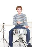 Young man playing drums Stock Images
