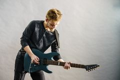Young man playing electric guitar Royalty Free Stock Image