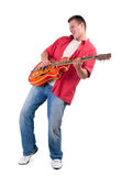 Young man playing on electric guitar Royalty Free Stock Image