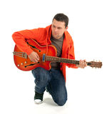 Young man playing on electric guitar Stock Photography
