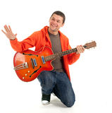 Young man playing on electric guitar Royalty Free Stock Photography