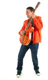 Young man playing on electric guitar Royalty Free Stock Images