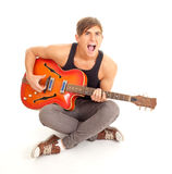 Young man playing electric guitar Royalty Free Stock Photography