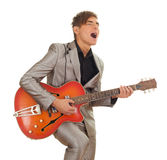 Young man playing on electric guitar Stock Image