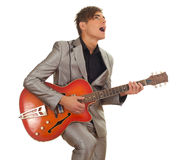Young man playing on electric guitar Stock Images