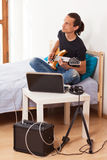 Young man playing electric guitar at home Royalty Free Stock Photography