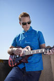 Young man playing electric guitar Stock Photography