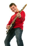 Young man playing the electric guitar Stock Image