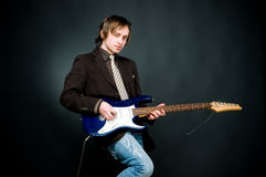 Young man playing electro guitar Stock Photos