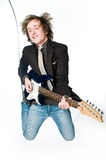 Young man playing electro guitar. Young man jumping with electro guitar, motion blur Royalty Free Stock Photo
