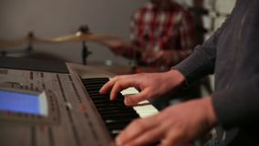Young man playing electronic keyboard stock footage
