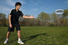 Young man playing frisbee Stock Photo