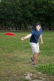 Young man playing frisbee outdoors Royalty Free Stock Photo