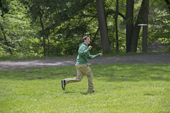 Young Man Playing Frisbee At The Park. Young Man Playing Frisbee Outdoors At The Park Stock Images