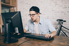 Young man playing game at home and streaming playthrough or walkthrough video Royalty Free Stock Photo