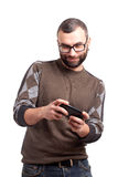 Young man playing games on smartphone Royalty Free Stock Photo