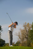 Young man playing golf Royalty Free Stock Photos