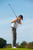 Young man playing golf Stock Photos