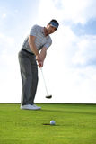 Young man playing golf Royalty Free Stock Photo