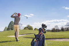 Young man playing golf on course. stock images