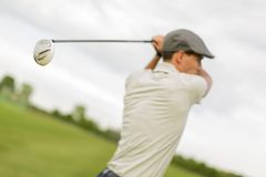 Young man playing golf Royalty Free Stock Image