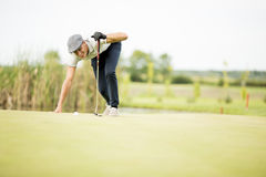 Young man playing golf. On the court Royalty Free Stock Photography
