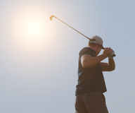Young man playing golf, golfer hitting fairway shot, swinging cl. Athletic young man playing golf, golfer hitting fairway shot, swinging club Royalty Free Stock Photography