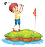 A young man playing golf Stock Images