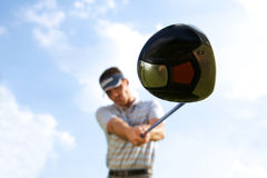 Young man playing golf, low angle view Stock Images