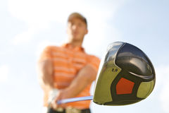 Young man playing golf, low angle view Stock Photo