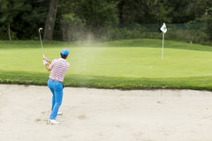Young man playing golf Stock Images