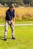 Young man playing golf Stock Photos