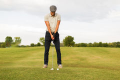 Young man playing golf Stock Image