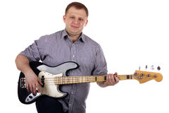 Young man playing guitar. Isolated on the white Royalty Free Stock Image