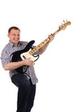 Young man playing guitar. Isolated on the white stock photography