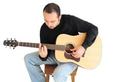 Young man playing the guitar Stock Image