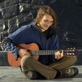 Young Man Playing Guitar Royalty Free Stock Images