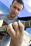 Young man playing the guitar Stock Photo