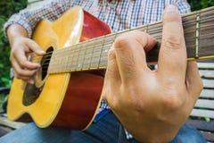 Young man playing guitar. Young man playing a guitar stock photos