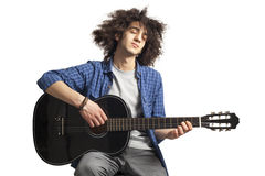 Young man playing guitar. Young man playing the guitar Stock Image
