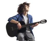 Young man playing guitar. Young man playing the guitar Stock Photo