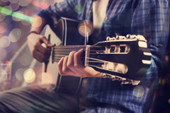 Young man playing guitar. Young man playing the guitar Stock Images